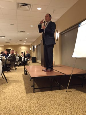 "Jeremie Kubicek, CEO of GiANT Worldwide, addresses Crawford 20/20 Vision's annual ""State of the Vision"" dinner earlier this month at the Trillium Event Center in Bucyrus."