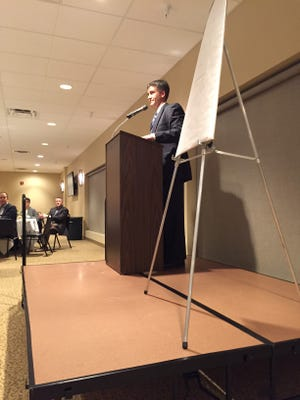 """Gary Frankhouse, executive director of the Crawford County Partnership for Education and Economic Development, addresses Crawford 20/20 Vision's annual """"State of the Vision"""" dinner in 2016 at the Trillium Event Center, Bucyrus."""
