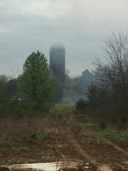 Murfreesboro firefighters had a hot job on a wet morning as they were called to a silo fire.