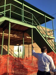 Ross Middle School Principal Jason Yturralde points to one of the school's outdoor, uncovered staircases during a tour for the El Paso Independent School District Facilities Advisory Committee on Monday.