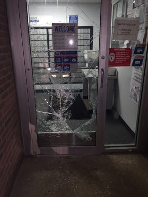 The front door of the post  office in Pemberton was smashed in a burglary last weekend. A reward is being offered by the U,.S. Postal Service for  information leading to an an arrest.