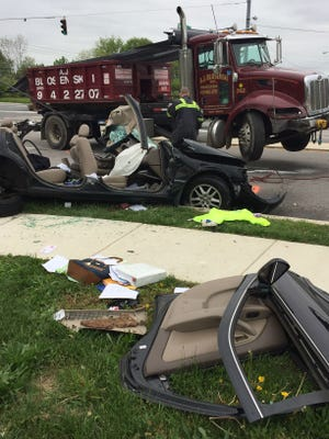 Pulaski Highway (U.S. 40) at Brookmont Drive in Bear is closed due to a serious crash involving a vehicle and dump truck that left a driver heavily entrapped, according to the Christiana Fire Company.