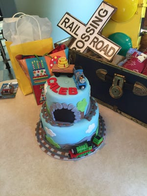 Caleb's train-inspired birthday cake was a perfect touch for his railroad-inspired birthday party.