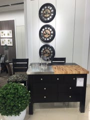 The Canadel gourmet kitchen island, available in almost two dozen colors, available at Younkers department store.