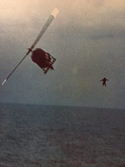 A pilot bails out over the China Sea after ditching his helicopter during the evacuation of Saigon in April, 1975.