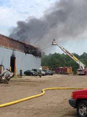 Fire burns Taylor's Towing in Wall.
