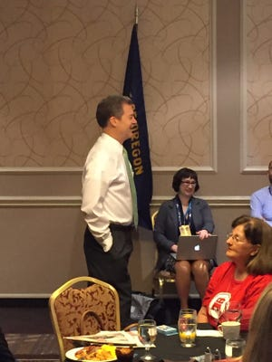 Kansas Gov. Sam Brownback speaks to members of the Oregon delegation at the Republican National Convention on Wednesday.