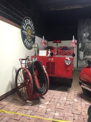 An old General Motors plant fire truck on display in the First Responders Exhibit at the R.E. Olds Transportation Museum.
