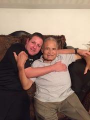 Pepe Luis Aragon Sr., of Binghamton, with his son Pepe Jr.