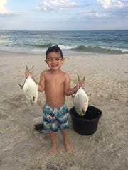 Jonah Rampersad, 3, reeled in two nice pompano on Johnson Beach.