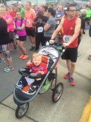 Jason Denton with his son during a recent race.
