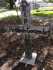 A long cross marks where Rosando Gonzales was killed