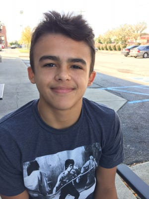 Johnny Parker, 14, is desperate to find a kidney donor for his dad.
