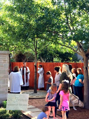 Luke Back, rector of the Episcopal Church of the Heavenly Rest, presides over a dedication ceremony Oct. 9 for a new pet columbarium in the church yard. The columbarium is located next to the columbarium for human cremains. Pet ashes will be buried or scattered in the pet columbarium..