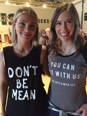 Lauren Paul (left) and Molly Thompson run the Kind Campaign, a nonprofit aimed at reducing girl-on-girl bullying. They presented a program to 1,000 middle-school girls Tuesday at Westfield Intermediate School.