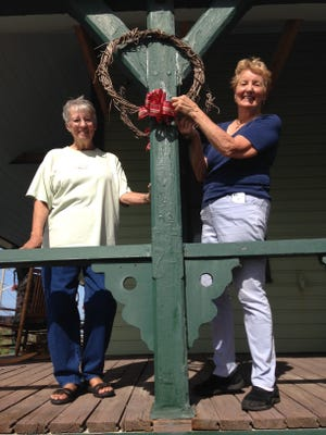 Master Gardeners Marie Allen and Ann McCormick prepare the House of Refuge Museum for the holiday season with homemade 1900 period decorations.