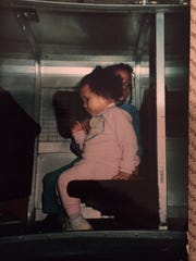 The columnist sits behind her sister Tiffany, getting ready to ride on the Midtown Plaza monorail, almost 30 years ago.