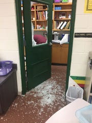The window of a door to a teacher's office was shattered during a New Year's Eve burglary at Riley Elementary.