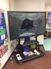 A touch screen device was shattered in one of Riley Elementary's classrooms during a break in on New Year's Eve.