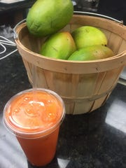 A Juicy Fruit juice is made of carrots, apples and oranges at The Juice Bar in Merchantville.