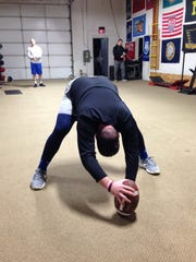 Following his workout at Jake's House of Iron, Jeremiah Riordan gets in some extra repetitions snapping the football. The velocity off his snaps rival that of a hard-throwing baseball pitcher.