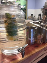 Infused water made with sage, lemon and cucumber greets customers at The Square Meal in Oaklyn.
