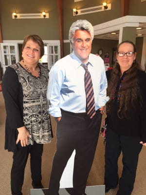 Suzette Brown (left) and Laura Shedd pose with a cutout of Jay Leno at Cancer Support Community. Leno will appear at the organization's fundraiser March 11 at Hilbert Circle Theatre. Tickets are available.