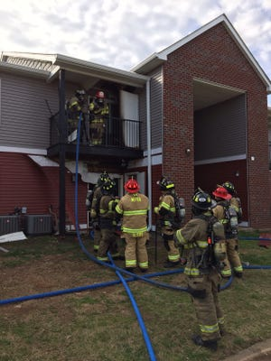 Murfreesboro firefighters battle a blaze at an apartment complex March 23, 2017.