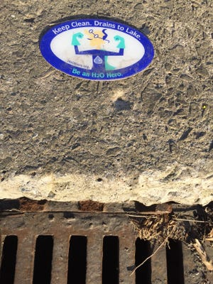 This Water Education Collaborative mascot reminds to be careful about what goes into storm drains.