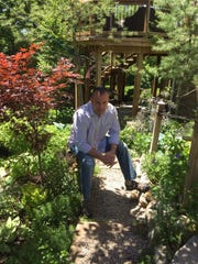 Mark Gorbe says gardening is a reprieve from stress. His garden will be on the Milford Garden Walk for the second time in three years.