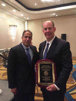 Dennis Heck (right) with Teaneck athletic director Todd Sinclair. Heck coached Teaneck football from 1988-2007.