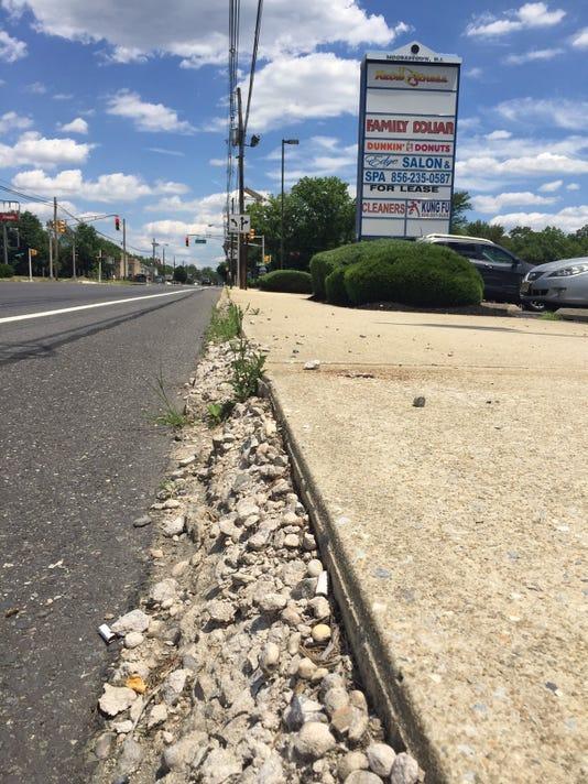 636341399973556288-Camden-Avenue-streetscape-crumbling-concrete-in-Moorestown-sLemola-section.JPG