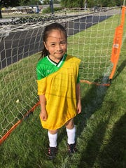 Rosa Parra-Pino takes her eye off the ball for a second. She is learning how to be a goalie at a summer soccer camp put on by Zionsville High School students and Iglesia Nueva Creacion church in Indianapolis.