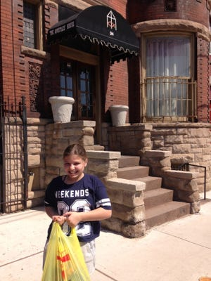 Hannah Kaplan donates nonperishable food to the Apostle's House in Newark. The rising seventh grader at Millburn Middle School's One-Can-a-Week program has been supported by residents in the Wyoming neighborhood for nearly six years.