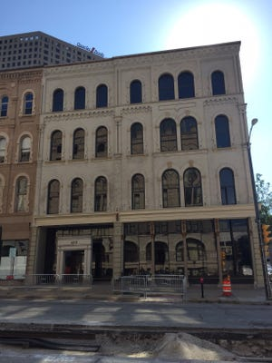 A four-story office building has been sold to the owner of the nearby Mackie and Mitchell historic buildings.