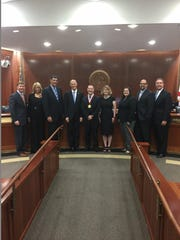 Partners in Association Management receive The Governor's Business Ambassador Award. Picture from left: Adam Putnam, Pam Bondi, Eric Thorn, Rick Scott, Bennett Napier, Amy Bean Napier, Rachael Luoma, John Ricco and Jeff Atwater, Chief Financial Officer.