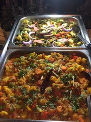 Mixed vegetable curry and Bhindi Masala are ready for the lunch crowd at Monsoon Fine Indian Cuisine.