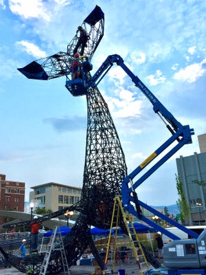 Crews work on installing the glass that encompasses the Space Whale sculpture that sits at City Plaza in downtown Reno on Aug. 4, 2017.