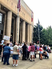 """About 50 people attended a rally in Great Falls on Sunday to """"stand with Charlottesville,"""" site of a deadly Neo-Nazi rally."""