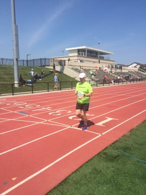 David Dugger, 78, of Howell, crosses the finish line in third place for the 1500m in the Michigan Senior Olympics on Sunday, Aug. 20, 2017, at the Oakland University campus.
