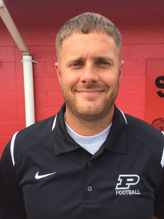 Pleasant football coach Aaron Cook