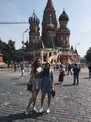 Emilie Scott (left) poses in front of Moscow's Saint