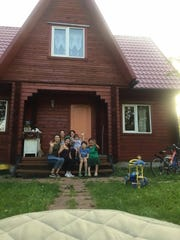 Emilie Scott (back left) with one of the Moscow families who hosted American dancesrs on weekends.