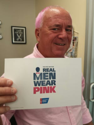 """Indian River County CommissionerPeter O'Bryan dyed his hair pink for the """"Real Men Wear Pink"""" campaign supporting the American Cancer Society's """"Making Strides against Breast Cancer."""""""