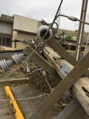 Downed concrete electric poles in Guaynabo. About 85 percent of the island remains without power.