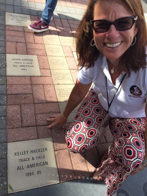 Kelly Hutto (formerly Hackler) poses with her All-American brick outside of Doak Campbell Stadium.