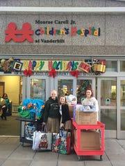 Each year, Bows & Ballcaps donates toys to Monroe Carell