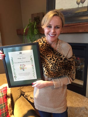 Kathy Mauer with her award from the Sheboygan Town and Country Garden Club.