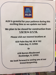 A sign outside the Melbourne Aldi store announces its closure.