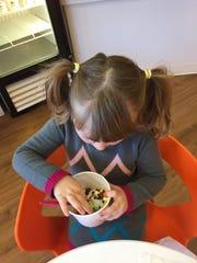 Enjoying the frozen yogurt - a reward for earning all the stars on her good behavior at chores chart.